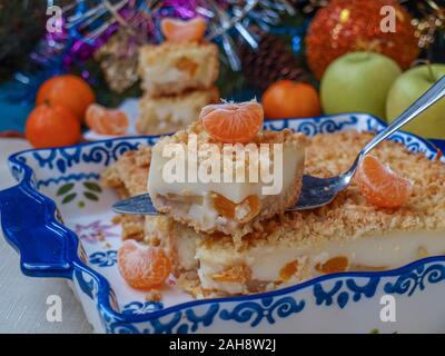 Homemade pie with apples and tangerines in ceramic form on a New Year background, horizontal orientation, Festive still life - Stock Photo