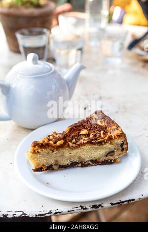 Almond, pear and hazelnut cake at the Petersham Nurseries cafe, Richmond, London, UK - Stock Photo