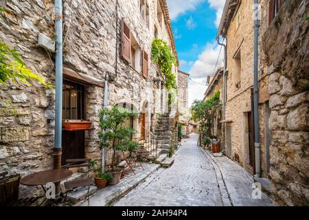 A picturesque back street of homes and apartments in the medieval village of Tourrettes Sur Loup in the Alpes_Maritimes area of Southern France. - Stock Photo