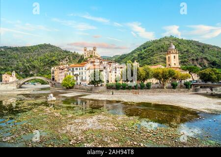The medieval village of Dolceacqua Italy, showing the San Filippo Church, hilltop Castello castle, arched Monet bridge, and ancient cathedral. - Stock Photo