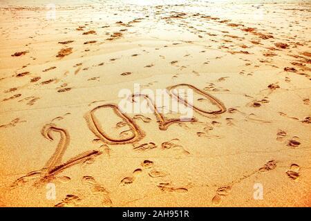 New Year 2020 inscription on the beach - Stock Photo