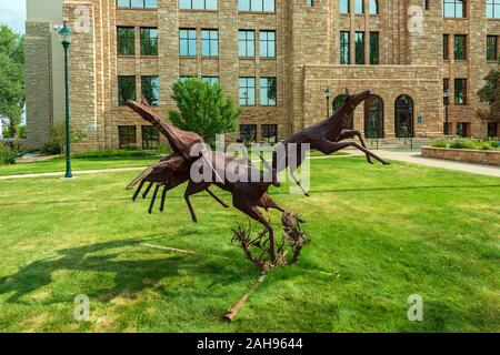 Laramie, Wyoming - July 25, 2014: A Steel Sculpture Depicting Four Pronghorns is Displayed on the Grounds of the Albany County Courthouse - Stock Photo
