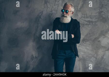Profile side photo of classy harsh masculine man in eyewear eyeglasses staring with crossed hands wearing coat trousers pants isolated over gray