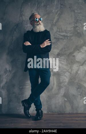 Full length photo of gorgeous harsh masculine man with his hands folded look have eyewear eyeglasses wearing coat jacket shoes isolated over gray