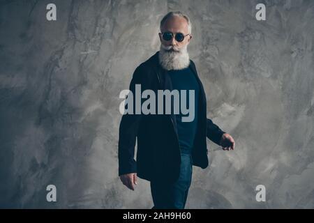 Profile side photo of handsome harsh masculine man in eyewear eyeglasses looking wearing coat black blazer jacket trousers isolated over gray