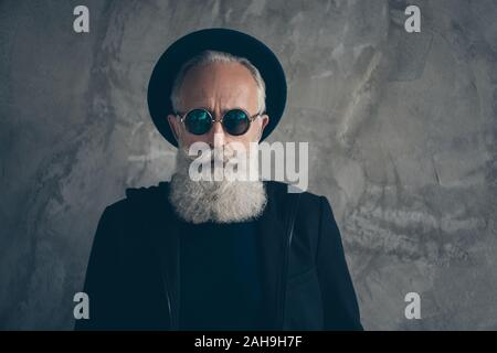 Close up photo of brutal harsh masculine old man stare in specs wearing hat coat isolated over grey background