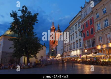 KRAKOW, POLAND - MAY, 11, 2018: St. Mary's Church and main square at night. - Stock Photo