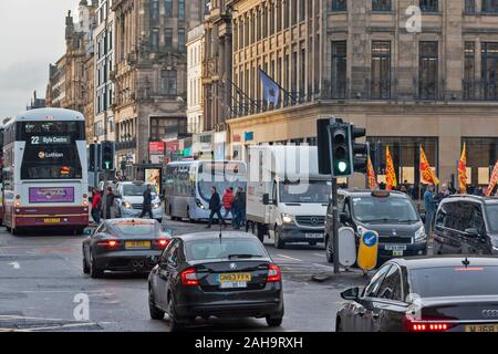 EDINBURGH SCOTLAND IN WINTER WITH TRAFFIC AND PEDESTRIANS ON PRINCES STREET - Stock Photo