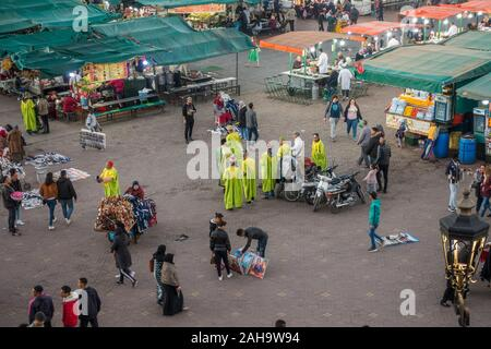 Jemaa el-Fna. street artists and food stalls and crowds at Jemaa El Fna Square in Marrakech, Morocco. - Stock Photo