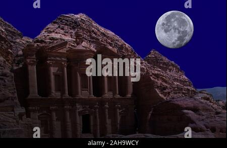 Composite image from the monastery Al-Deir in Petra, Jordan with a large bright full moon in the sky. Elements of this image furnished by NASA - Stock Photo