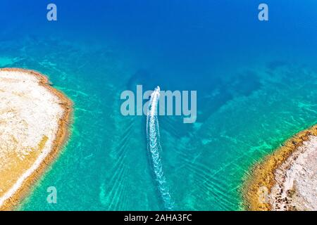 Archipelago of Croatia speed boat on turquoise sea, stone desert islands of Zadar, Dalmatia region of Croatia - Stock Photo