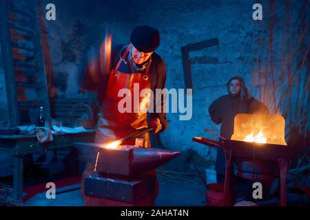 Italy, Sicily, Partinico, December 22/2019,beautiful living nativity scene in the Parrini district, blacksmith at work with his assistant - Stock Photo