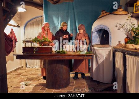 Italy, Sicily, Partinico, December 22/2019, beautiful living nativity scene in the Parrini district, women work on spices - Stock Photo