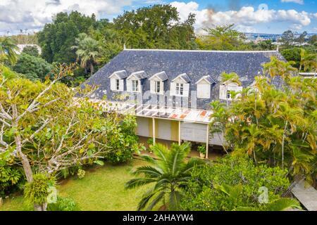 Lush tropical gardens and tiled roof of Eureka La Maison Creole old colonial house, Moka, Indian Ocean, Mauritius
