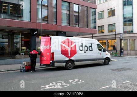 A DPD delivery van outside WeWork on Wilson Street in Finsbury East London EC2 England UK  KATHY DEWITT