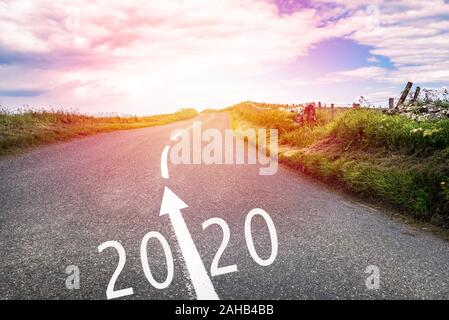 New year 2020 ahead. Conceptual country road with 2020 and an arrow painted on asphalt. - Stock Photo
