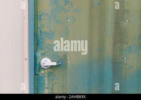 Green metal siding on door background texture - Stock Photo