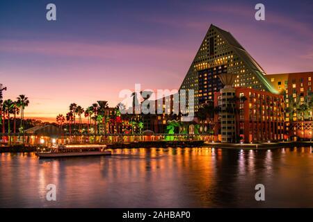 Orlando, Florida.  December 18, 2019. Walt Disney World Dolphin Hotel  and taxi boat in Lake Buena Vista. - Stock Photo