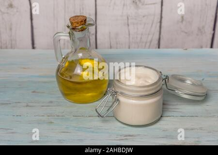 Homemade olive oil face cream, in glass jar, with oil filled with olive oil. Medicine and alternative health - Stock Photo