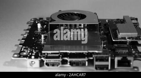 Fan fins of a cooling fan on motherboard in black and white - Stock Photo