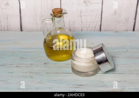 Homemade olive oil face cream, in glass jar. Medicine and alternative health. - Stock Photo