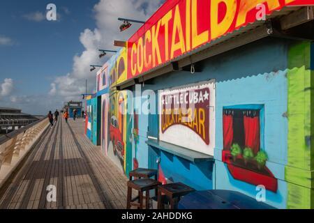 Scheveningen, the Netherlands - October 3, 2017: Colorful sales booth on Scheveningen pier upper deck - Stock Photo