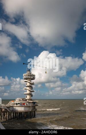 Scheveningen, the Netherlands - October 3, 2017: A white bungee tower wheel at the pier of Scheveningen with north sea in the background - Stock Photo