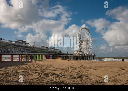 Scheveningen, the Netherlands - October 3, 2017: Pier of Scheveningen with ferris wheel and bungee tower seen from the right side - Stock Photo
