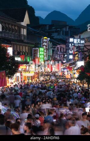 Shopping street of Yangshuo. Yangshuo is a popular tourist county and it is a city near to Guilin Guangxi. The main shopping streets of Yangshuo.