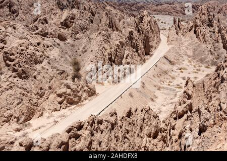 View of the gravel surfaced route 40 road passing through the Quebrada de las Flechas mountain region, just north of the town of Cafayate, Argentina.