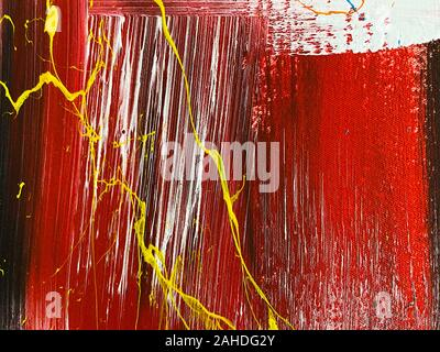 Red, yellow and white strokes of paint on the fabric. Abstract textured background. - Stock Photo
