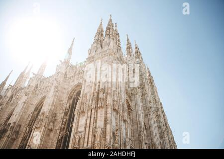 Beautiful view of the ancient Duomo Cathedral in Milan in Italy. It is one of the most popular tourist attractions in Italy.
