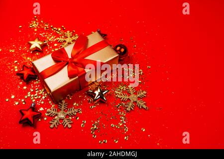 Red and gold christmas ornaments, frame with copy space, red background.