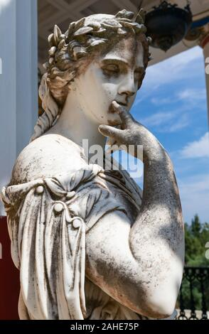 Marble statue of muse Calliope in the Courtyard of the Muses, Achilleion Palace, Corfu, Greece - Stock Photo