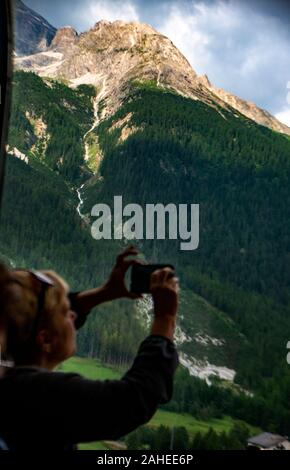 Scenes from the Bernina Express, a train connecting Chur in Switzerland to  Tirano in Italy by crossing the Swiss Engadin Alps - Stock Photo