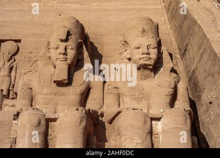Abu Simbel - Two Colossal Statues of Pharaoh Ramesses II on the Great Temple in Egypt - Stock Photo