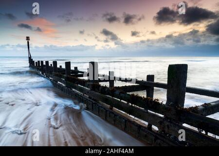 Sunset on Mundesley Beach in North Norfolk, UK on an Autumn evening - Stock Photo