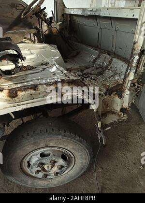 disassembled interior of a truck wrecked in a car accident - Stock Photo