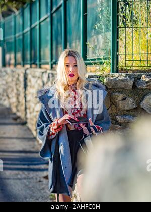 Fair-haired blonde fairhair blond hair fairhaired Caucasian waiting wait for sms facebook inbox message just notice noticed stalker - Stock Photo