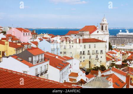 Lisbon, Portugal : High angle view of the Alfama district as seen from Largo das Portas do Sol viewpoint. The Alfama is the oldest district of Lisbon. - Stock Photo