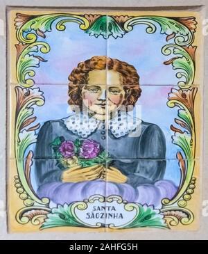 Santa Saozinha (Sãozinha de Alenquer) Christian Religious art in hand painted ceramic tiles. Photographed in Nazare, Portugal - Stock Photo