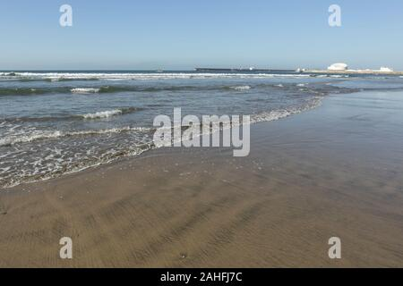 Empty Matosinhos beach, near Oporto, Portugal, seeing Leixoes harbor entry. - Stock Photo