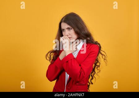 Sickness woman in white shirt and red jacket cough, keeping hand on chest - Stock Photo