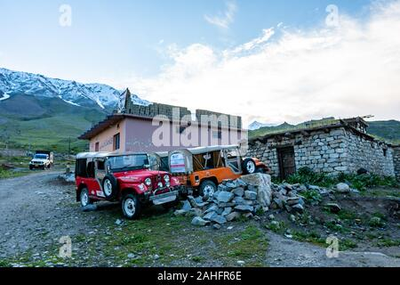 Deosai National Park Chilum Village Parked Jeeps at a Guesthouse in the Morning with Blue Sky - Stock Photo