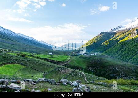 Deosai National Park Chilum Village Picturesque Breathtaking Landscape View of Common Houses in the Morning with Sunrise Blue Sky - Stock Photo