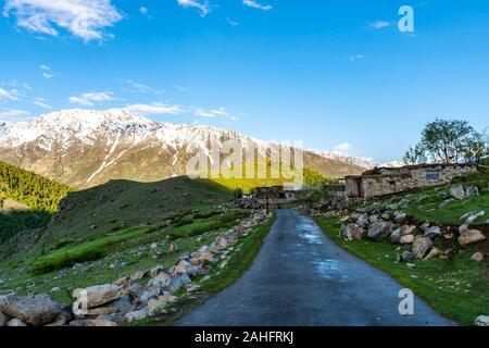 Deosai National Park Chilum Village Picturesque Breathtaking View of Common Houses in the Morning with Sunrise Blue Sky - Stock Photo