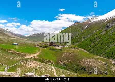 Deosai National Park Chilum Village Picturesque Breathtaking View of Landscape with Snow Capped Mountains on a Sunny Blue Sky Day - Stock Photo