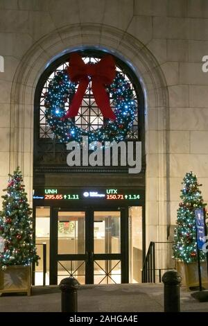 The New York Stock Exchange is festively decorated with lights and garlands during the holiday season, NYC, USA - Stock Photo