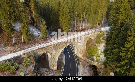 Aerial drone view of an old viaduct in the forest. Hellertal viaduct, Harz mountains, Lower Saxony, Germany. - Stock Photo