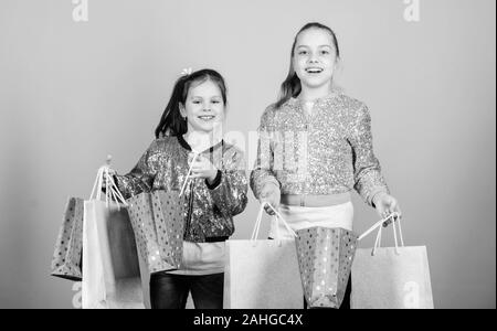 Happy children. Little girl sisters online shopping. Sales and discounts. Sisterhood and family. savings on purchases. Kid fashion. shop assistant with package. Small girls with shopping bags. - Stock Photo